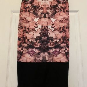 Mirrored design, fitted skirt